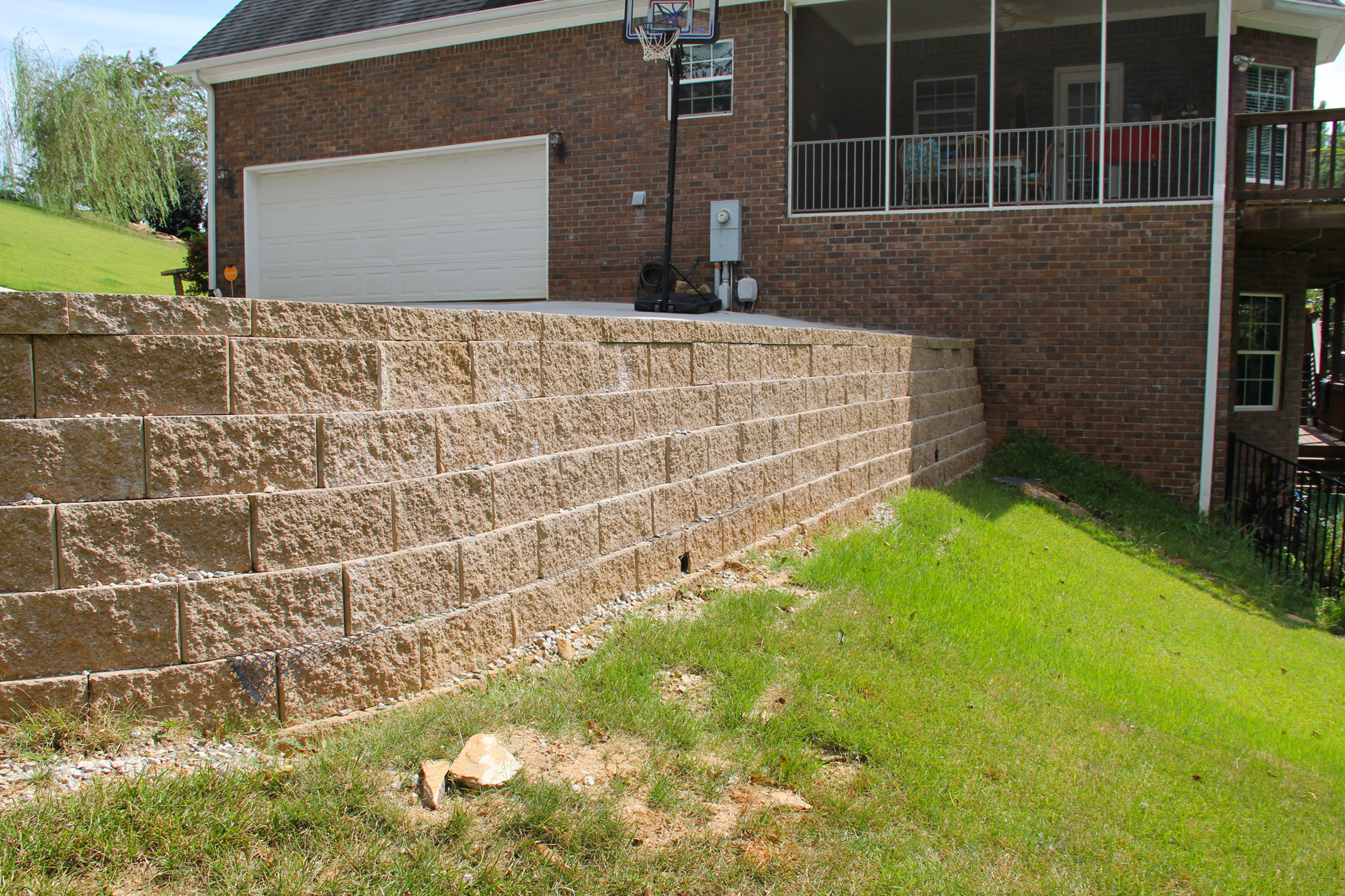 Landscaping lawn care and retaining walls between the for Landscaping rocks augusta ga