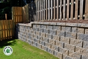 Retaining-wall-meets-fence-hardscape-architect-Between-the-Edges-NorthAugustaSC
