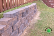 Close-up-retaining-wall-along-fence-Between-the-Edges-North-Augusta-SC