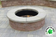 close-up-paver-raised-fire-pit-hardscaping-Between-the-Edges-Augusta-GA