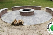 round-fire-pit-with-seating-walls-Between-the-Edges-landscaper-Appling-GA