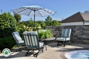 Outdoor-patio-with-retaining-wall-privacy-landscaper-Between-the-Edges-AugustaGA