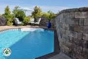 Retaining-wall-beside-pool-Between-the-Edges-AugustaGA