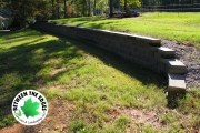 Retaining-wall-curved-side-Between-the-Edges-landscaping-EvansGA