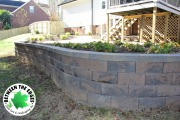 curved-retaining-wall-with-landscaping-beds-Between-the-Edges-landscape-design-North-Augusta-SC