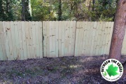 wood-fence-with-gate-Between-the-Edges-landscaper-Augusta-GA