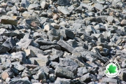 close-up-of-rocks-in-drainage-ditch-residential-landscaping-Between-the-Edges-Grovetown-GA