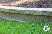 close-up-retaining-wall-grass-mulch-Between-the-Edges-Augusta-GA-landscaper
