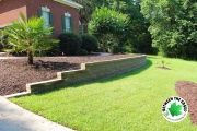 curved-retaining-wall-surrounding-front-landscaping-beds-Between-the-Edges-North-Augusta-SC-hardscaping