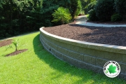 retaining-wall-with-mulch-flower-bed-in-front-yard-Between-the-Edges-Aiken-SC-retaining-wall-specialist