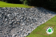 rock-lining-drainage-ditch-at-residential-home-Between-the-Edges-North-Augusta-SC-landscaping