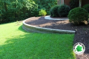 side-view-curved-retaining-wall-with-landscaping-bed-Between-the-Edges-Grovetown-GA
