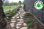 stone-path-with-mulch-and-flowers-surrounding-landscape-designer-Between-the-Edges-Evans-GA