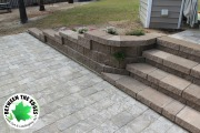 Curved-retaining-wall-with-steps-Between-the-Edges-landscaper-Augusta-GA
