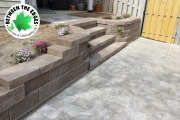 retaining-wall-with-steps-and-paver-path-Between-the-Edges-hardscape-design-Evans-GA