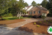 full-view-of-paver-driveway-and-landscaping-Between-the-Edges-Harlem-GA